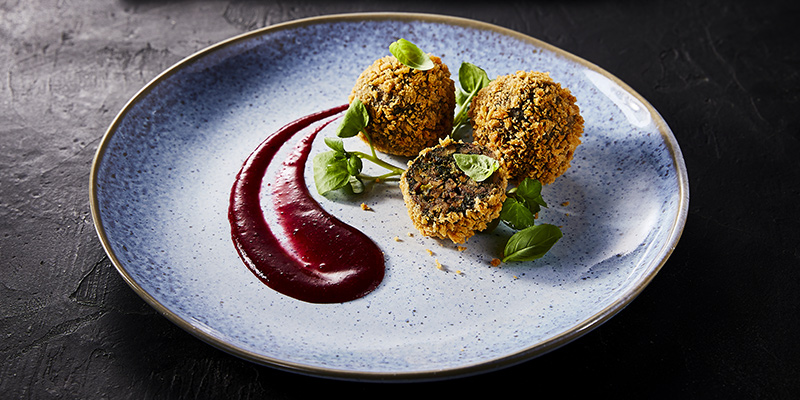 Kale, Chestnut and Mushroom Bonbons with Cherry Sauce - A plate of food on a table - Falafel