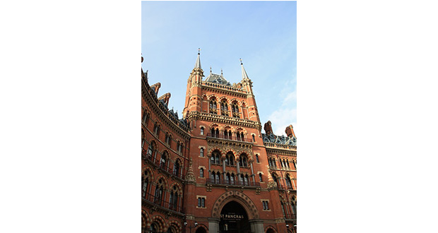 A Rough Start To The Final Quarter Of 2019 For UK Hotels - A large brick building with St Pancras railway station in the background - Photography